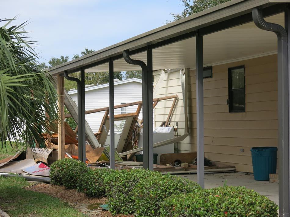 Attached laundry room was completely destroyed with no significant damage to main structure or the carport.