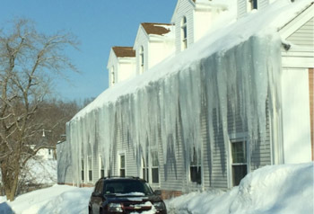 Impressive icicles on a house in Braintree, Massachusetts